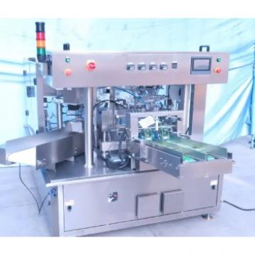 Automatic Rotary Dog Food/Liquid/Water Filling and Sealing Packing/Package/Packaging Machine 500pieces/Year